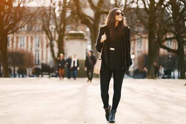 Curvy sexy French girl walking during a sunny day in a beautiful city of Paris