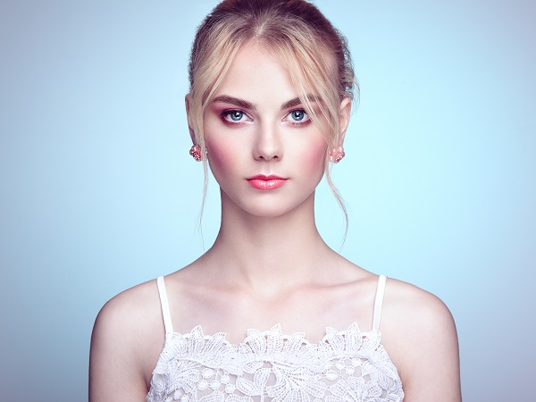 Fashionable portrait of a beautiful young Norwegian woman with blond hair