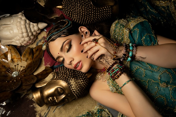 Gorgeous Jordanian woman lying in pieces of jewelry all alone