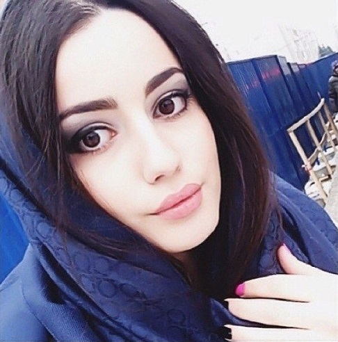 Beautiful Chechen girl posing in front of a camera