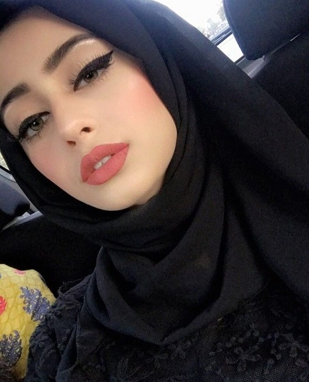 Sexy Iraqi girl wearing attractive makeup sitting in a car alone