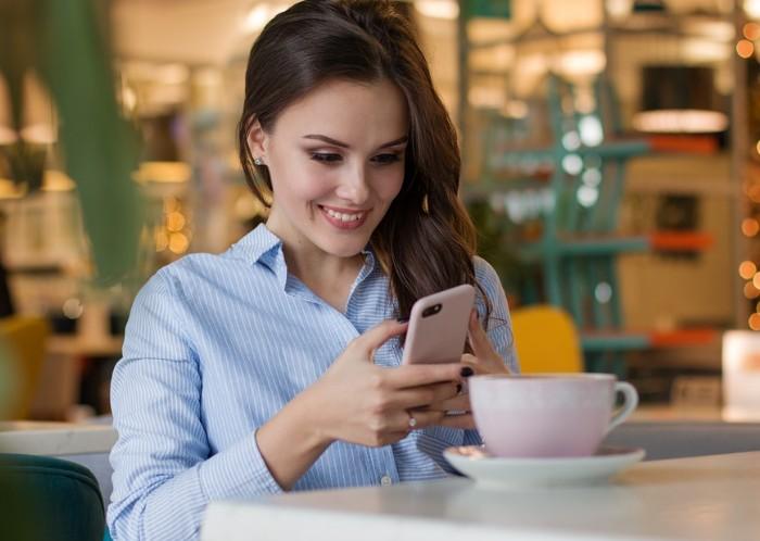 Image of woman using app