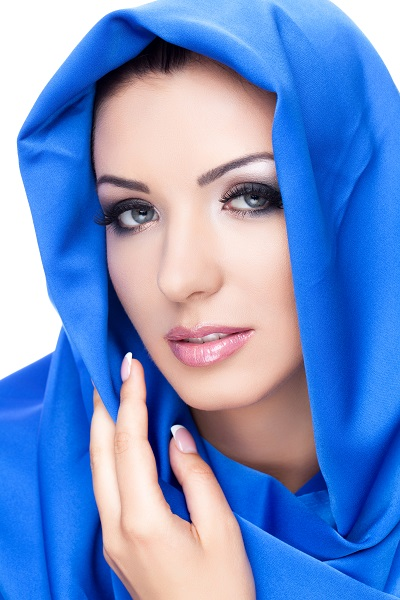 Charming Chechen lady wearing a blue scarf posing