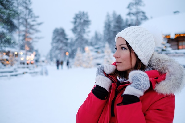 Happy attractive Swedish woman posing for the camera in a snow landscape