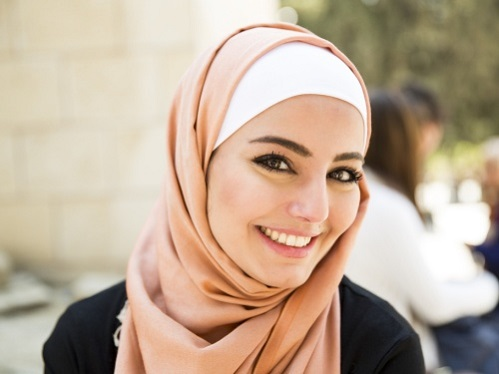 Smiling young Jordanian lady posing in front of a camera